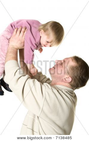 Father Tossing Up A Child