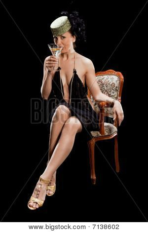 Sexy Woman Sitting On Arm Chair,  With Glass Of Cocktail I