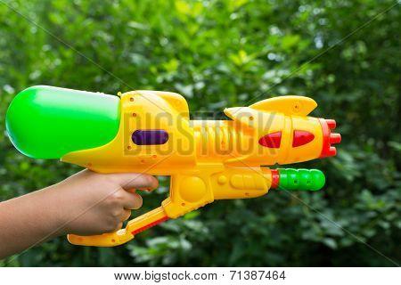 Children Water Gun In A Children's Hand