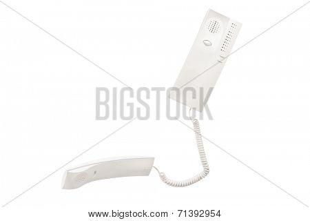 Studio shot of a white plastic intercom isolated on white background