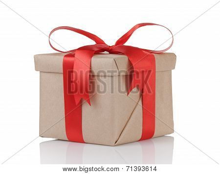 One Gift Christmas Box Wrapped With Kraft Paper And Red Bow