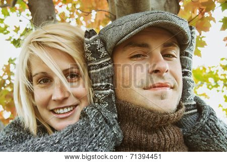 Young couple having some outdoor autumn fun