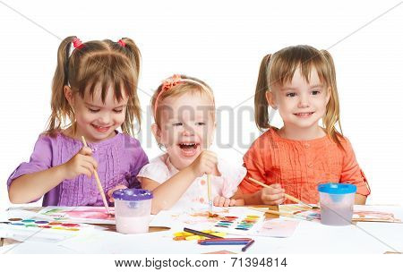 Happy Little Girl In Kindergarten Draw Paints On White Background