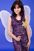 pic of tinkerbell  - young beautiful woman dressed as tinkerbell studio picture - JPG