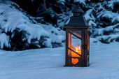 picture of rest-in-peace  - a lantern lights up in the snow at christmas - JPG