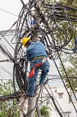 stock photo of lineman  - Electrician repair system of electric wire - JPG