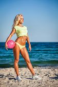 stock photo of volleyball  - Beach woman in bikini holding a volleyball - JPG