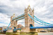 stock photo of combine  - London Tower Bridge is a combined bascule and suspension bridge in London which crosses the River Thames - JPG
