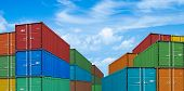 picture of export  - export or import shipping cargo containers stacks in port under sky - JPG