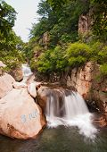 picture of tourist-spot  - The tourists in China Qingdao laoshan scenic spot the cascades - JPG
