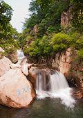 foto of tourist-spot  - The tourists in China Qingdao laoshan scenic spot the cascades - JPG