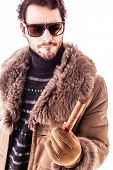 image of hustler  - a young and rich man wearing a sheepskin coat isolated over a white background holding a cigar - JPG