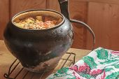 stock photo of dutch oven  - Traditional stew meal cooked in Russian wood-fired oven