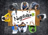 stock photo of negotiating  - Group of People Brainstorming about Negotiation Concept - JPG