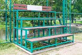 pic of bleachers  - Small bleachers near the sport filed of urban park - JPG