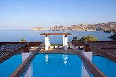 image of infinity pool  - luxurious swimming pool with beautiful sea view - JPG