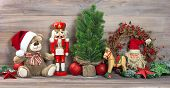 picture of nutcracker  - nostalgic christmas decoration with antique toys teddy bear and nutcracker - JPG