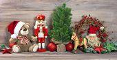image of nutcrackers  - nostalgic christmas decoration with antique toys teddy bear and nutcracker - JPG