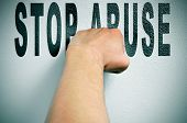 foto of stop fighting  - a man punching the text stop abuse - JPG