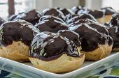 picture of eclairs  - Homemade eclairs are covered with a coat of chocolate ganache  - JPG