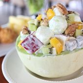 image of cantaloupe  - Fruit salad in cantaloupe bowl in the restaurant - JPG