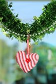 picture of glass-wool  - Red heart fabric hanging on glass background [[** Note: Shallow depth of field] ** Note: Soft Focus at 100%, best at smaller sizes - JPG
