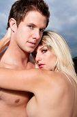 picture of nude couple  - Goodlooking young couple topless on the beach - JPG