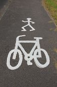 image of street-walker  - cycle and pedestrian route symbol painted on tarmac - JPG