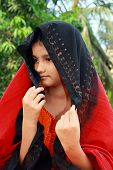 stock photo of rajasthani  - A beautiful and Rajasthani girl shying away from the camera - JPG