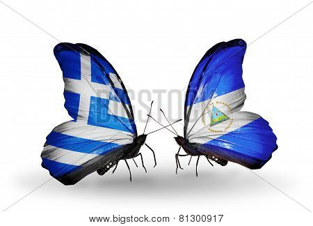 Two Butterflies With Flags On Wings As Symbol Of Relations Greece And Nicaragua