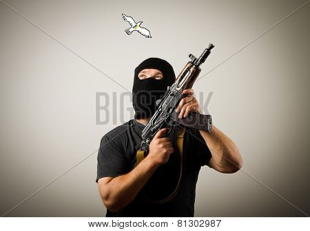 Man With Gun And Peace Dove Of Ukraine.