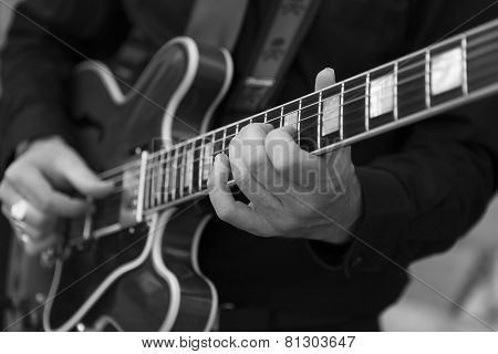 Hand playing guitar