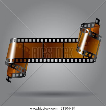 Curled photo film strip on gray background. Movies concept. Contain the Clipping Path