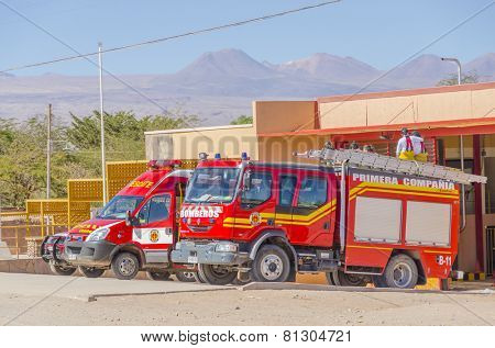 SAN PEDRO DE ATACAMA, CHILE, MAY 18, 2014: Fire trucks park in front of fire station