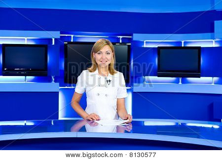 Television Anchorwoman At Tv Studio