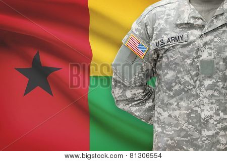 American Soldier With Flag On Background - Republic Of Guinea-bissau