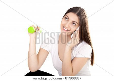 Smiling Girl Talking On Phone And Lifting Green Color Dumbbells