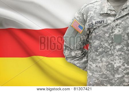American Soldier With Flag On Background - South Ossetia