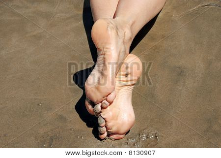 Crossed Feet In Sand