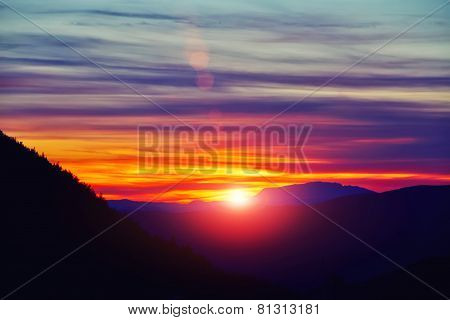 Rising sun in mountains, beautiful sunset over the mountains