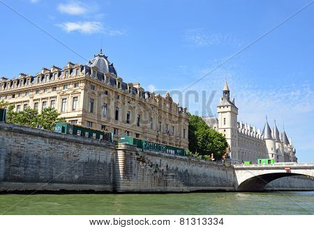 Historic La Conciergerie Buildings & Towers On The Banks Of The Seine River, Paris France.