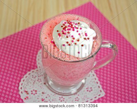 pink cake in a mug