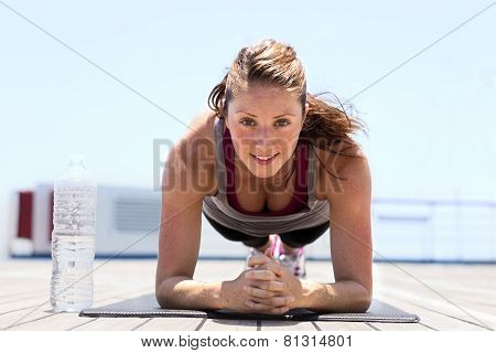 Young girl doing plank