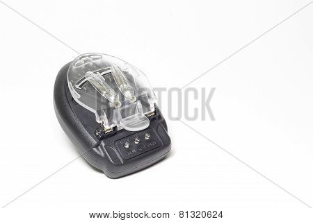 Multifunctional battery charger isolated on black background