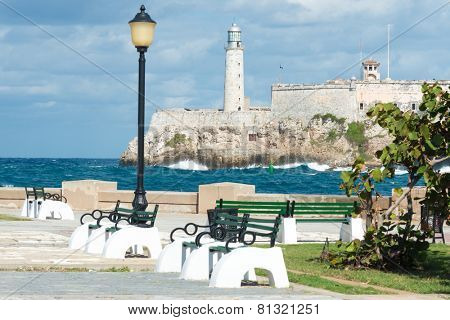 The castle of El Morro in Havana with a beautiful park on the foreground