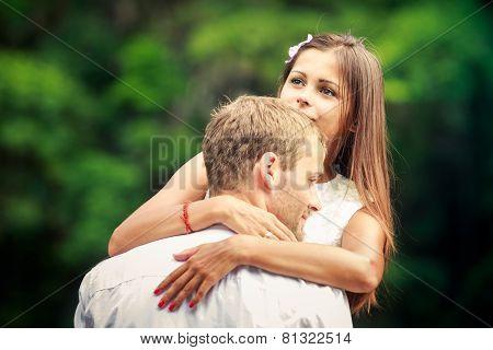 Brunette Bride Hugging Her Handsome Groom