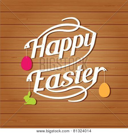 Happy easter lettering. White  letters text  on brown wood background