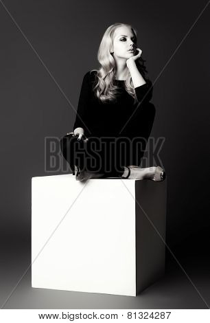 Black-and-white art portrait of a beautiful slim young woman in black fitting clothing. Beauty, fashion. Body care.