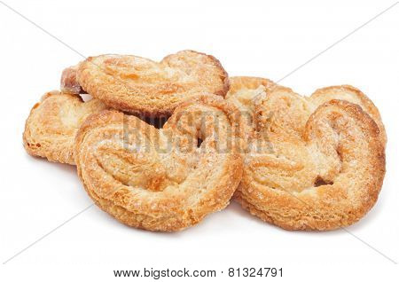 some palmeras, spanish palmier pastries, on a white background