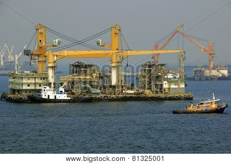 floating cranes waiting for work